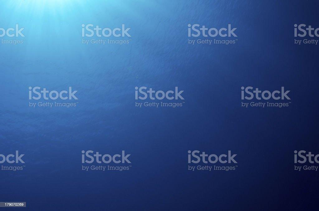 Deep Blue underwater back-drop in the ocean stock photo