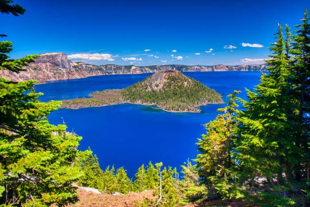 Deep blue waters of crater lake oregon and wizard island stock photo