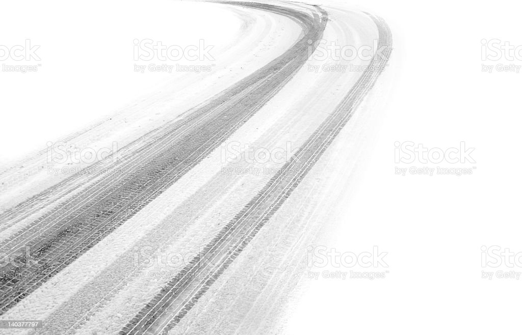 Deep cold tire tracks that have been left in the snow stock photo