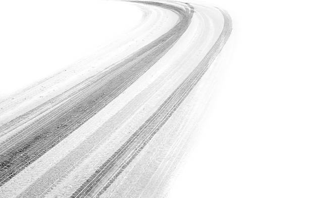 Deep cold tire tracks that have been left in the snow tyre tracks in the snow, fading into white on both sides tire track stock pictures, royalty-free photos & images