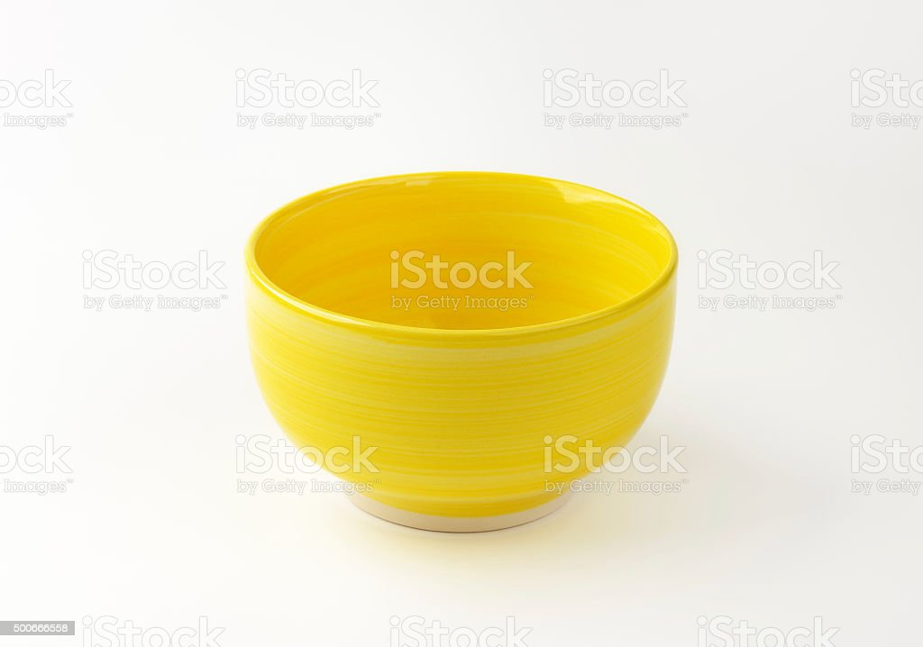 Deep footed yellow bowl stock photo
