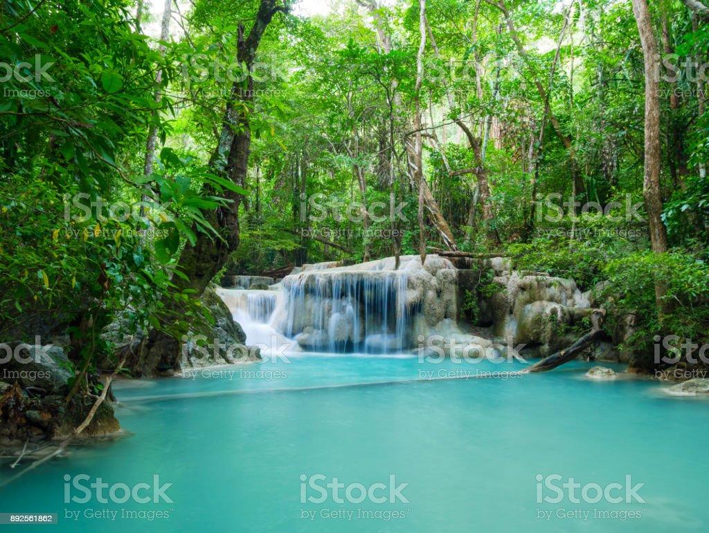 Deep forest waterfall in Thailand (Erawan Waterfall) stock photo
