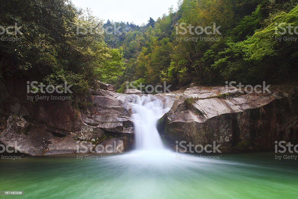 Deep forest waterfall in Wuyuan, China. royalty-free stock photo