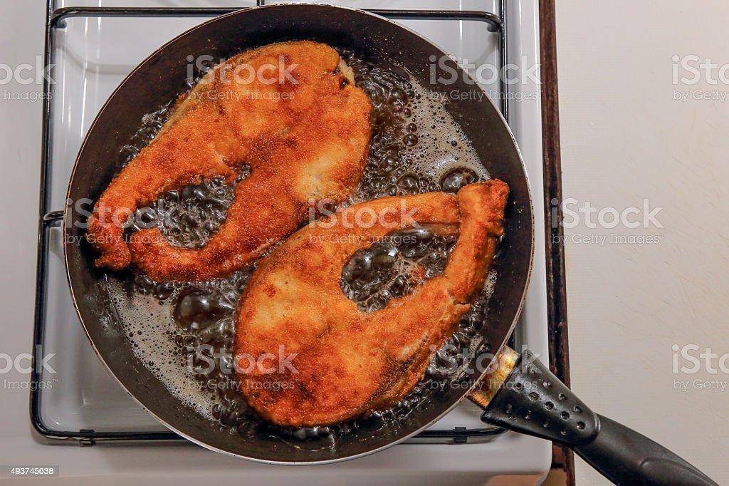 Deep fried breaded red fish steak stock photo