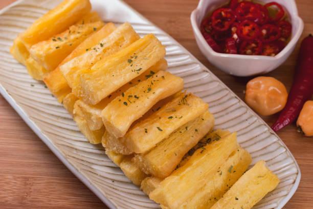 Deep fried cassava root. Brazilian food mandioca frita stock photo