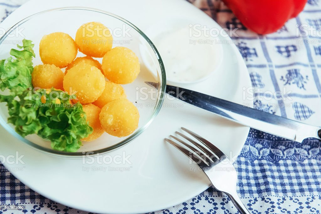 Deep fried cheese balls with lettuce and sauce stock photo