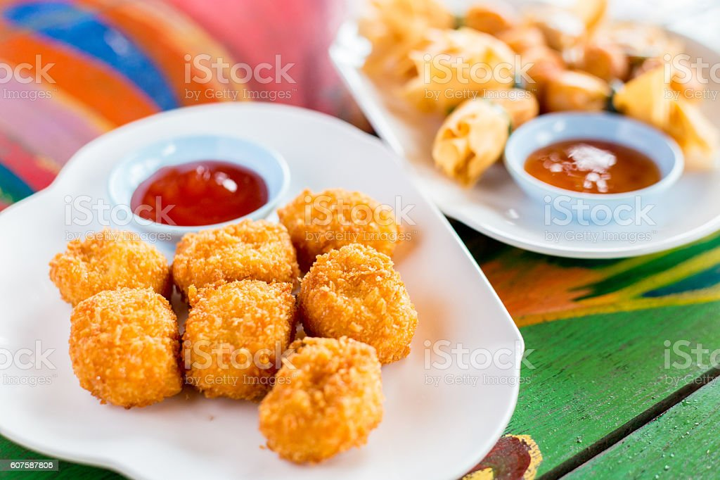 Deep fried chicken nuggets with tomato sauce stock photo
