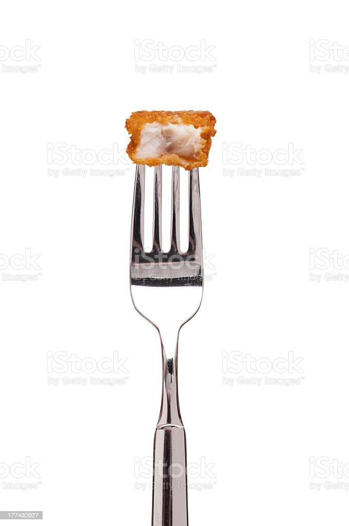 Deep fried fish stick on a fork stock photo