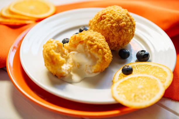 deep fried ice cream ball tempura dessert close-up - tempura imagens e fotografias de stock