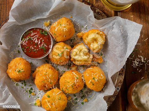 Deep Fried Macaroni and Cheese Balls with a Couple of Beers and Marinara dipping Sauce