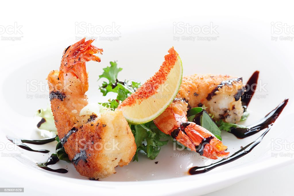 Deep fried shrimps on white plate stock photo