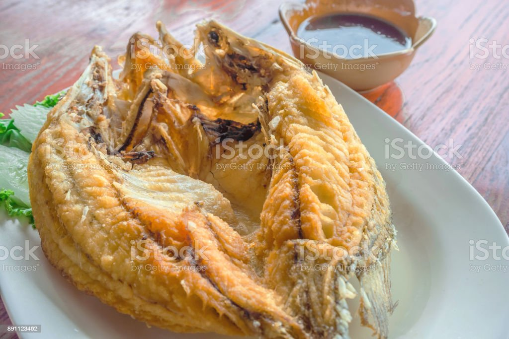 Deep Fried Snapper topped with Sweet Fish Sauce stock photo