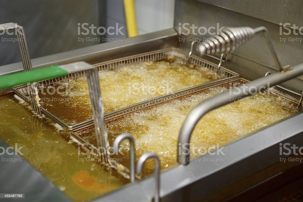 Deep fryer with boiling oil stock photo