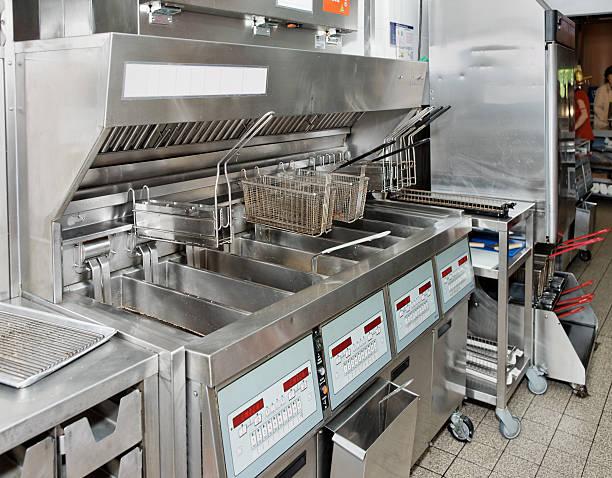 Deep fryer with on restaurant kitchen stock photo