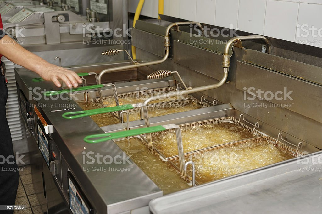 Deep fryers with boiling oil stock photo