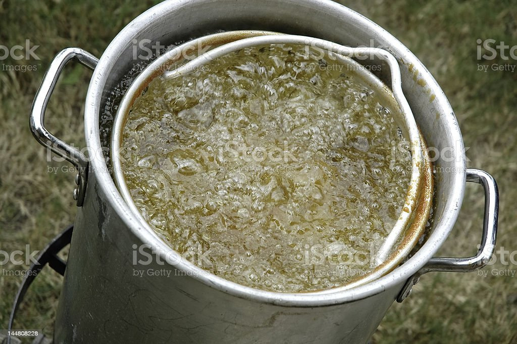 Deep frying a turkey stock photo