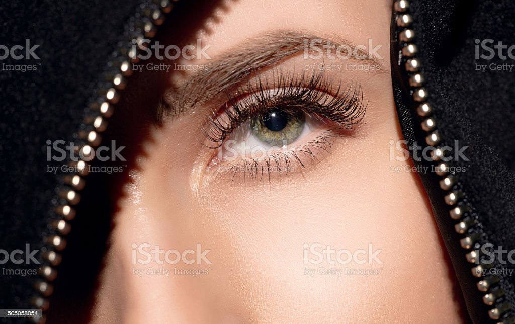 deep green eye looking up stock photo