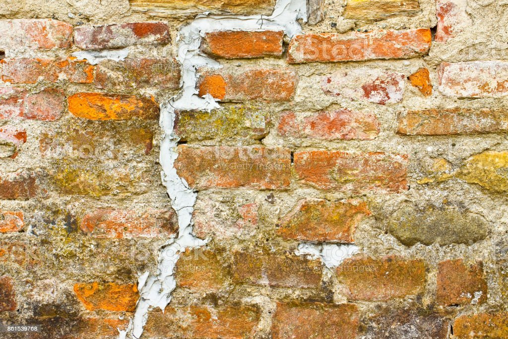 Deep grouted crack in old brick wall - concept image with copy space stock photo
