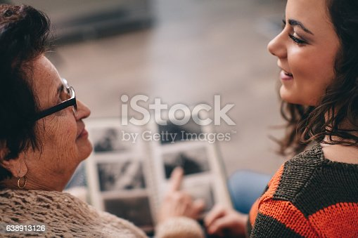Granny showing her granddaughter memories from past