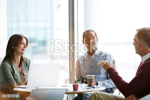 istock Deep in office discussions 647574748