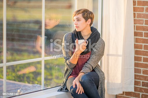 istock Deep in thought and looking out the window 952488140