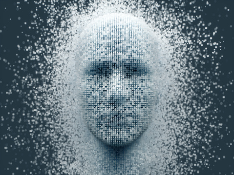 3D dissolving human head made with cube shaped particles.