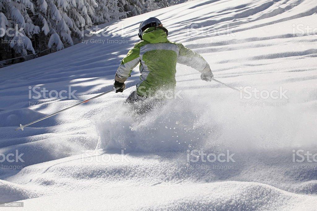 Deep powder snow with female skier stock photo