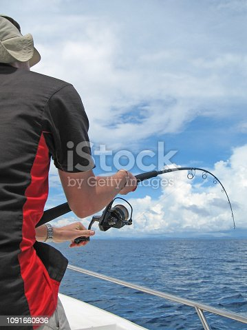 istock Deep sea fishing, catch of fish, fish fight 1091660936