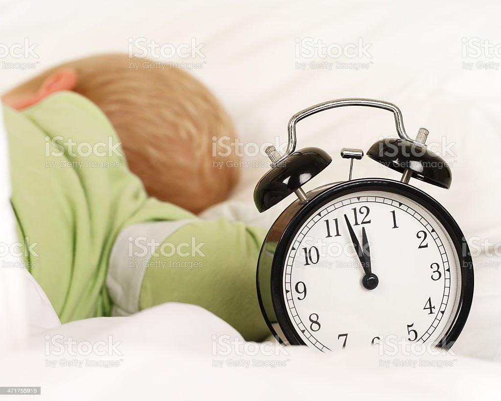 Deep Sleep with alarm clock royalty-free stock photo
