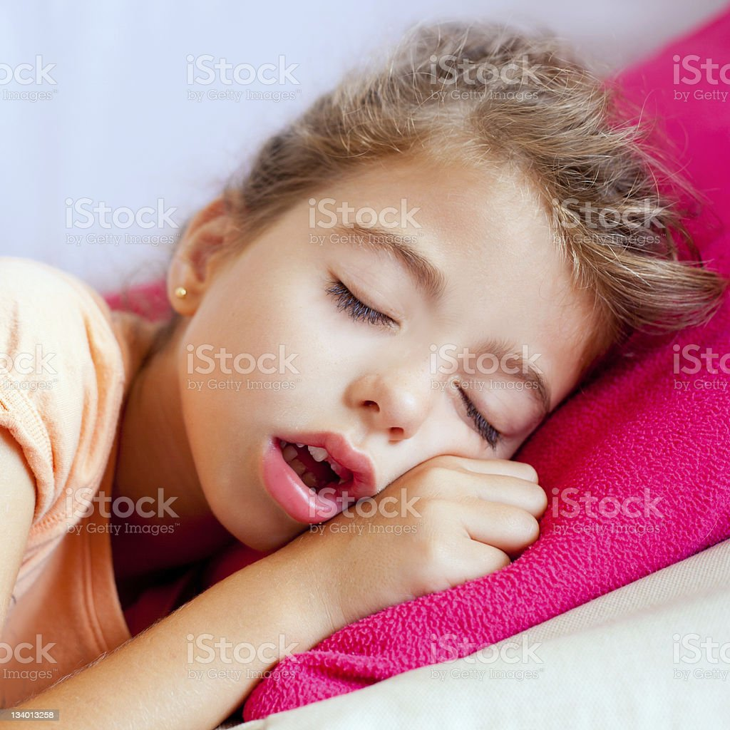 Deep sleeping children girl closeup portrait stock photo