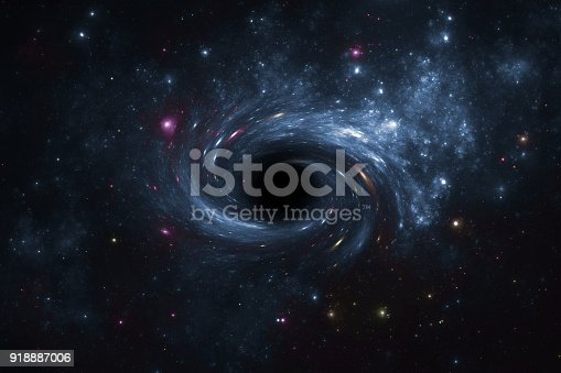 istock Deep space star field with black hole. 918887006