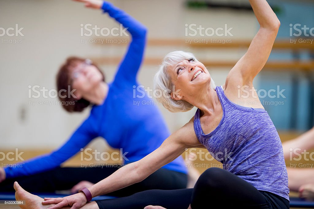 Deep Stretching in Yoga Class stock photo