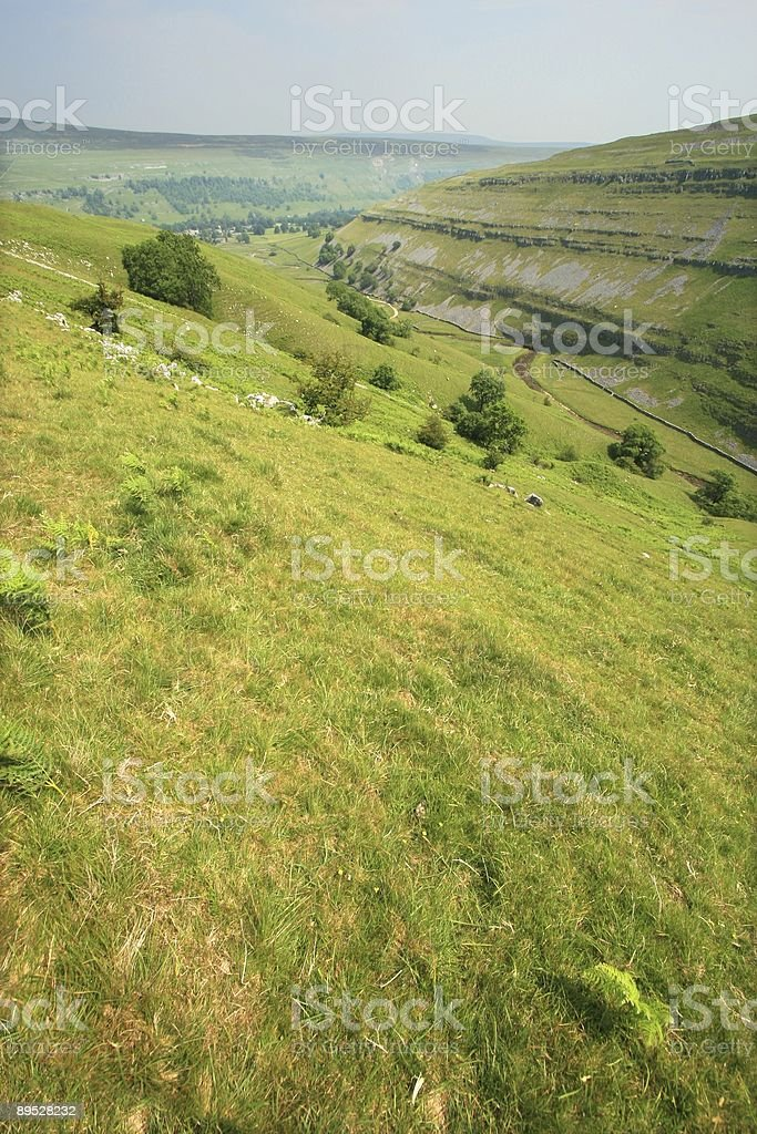 Deep valley with well defined rock strata royalty-free stock photo