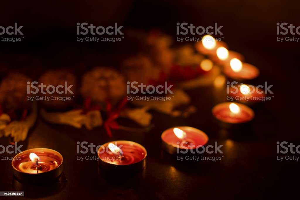 Deepabali - colourful candles are lit in darkness stock photo