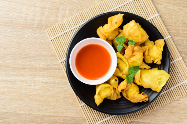 Deep-fried crispy wonton stuffed with minced pork stock photo