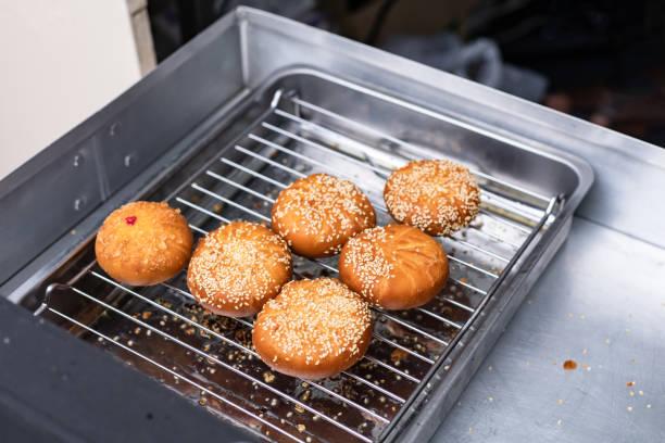Deep-fried dough stick on plate. stock photo