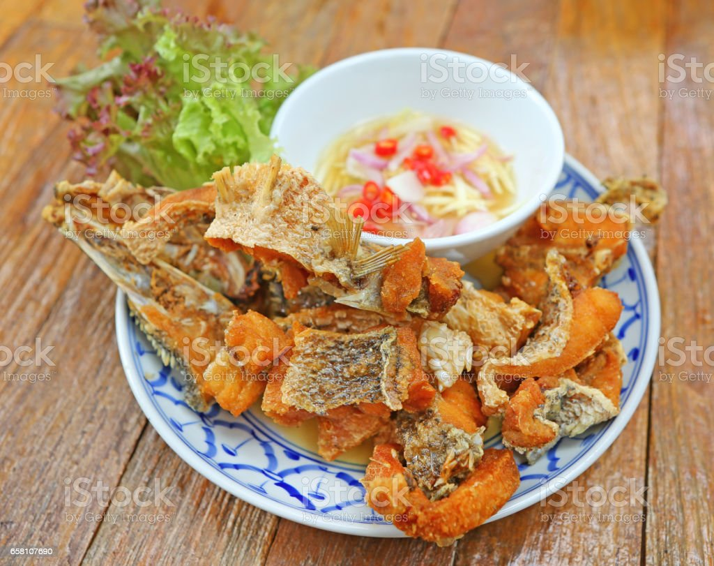 Deep-Fried Sea Bass With Fish Sauce stock photo