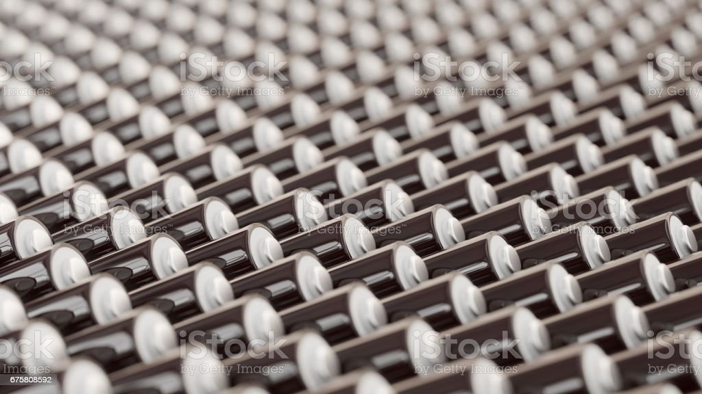 Deeply Layered Lines of Black and White AAA Batteries stock photo