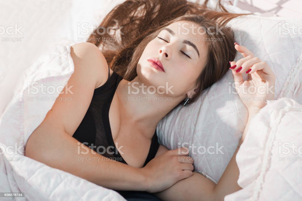 Deeply sleeping woman in morning portrait stock photo