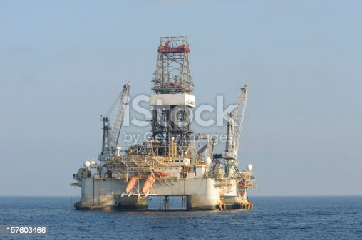 A floating deep water dynamically positioned semi-submersible oil drilling on location at sea.