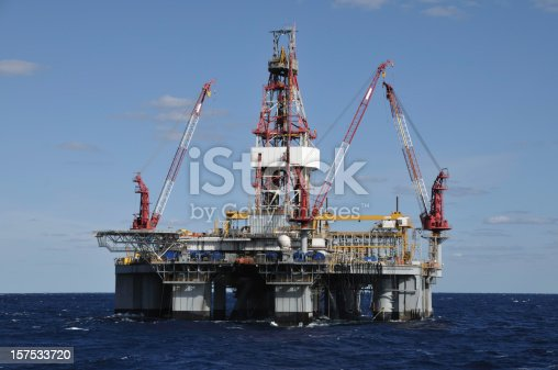 A floating deep water semi-submersible oil drilling on location at sea. An anchored oil rig.