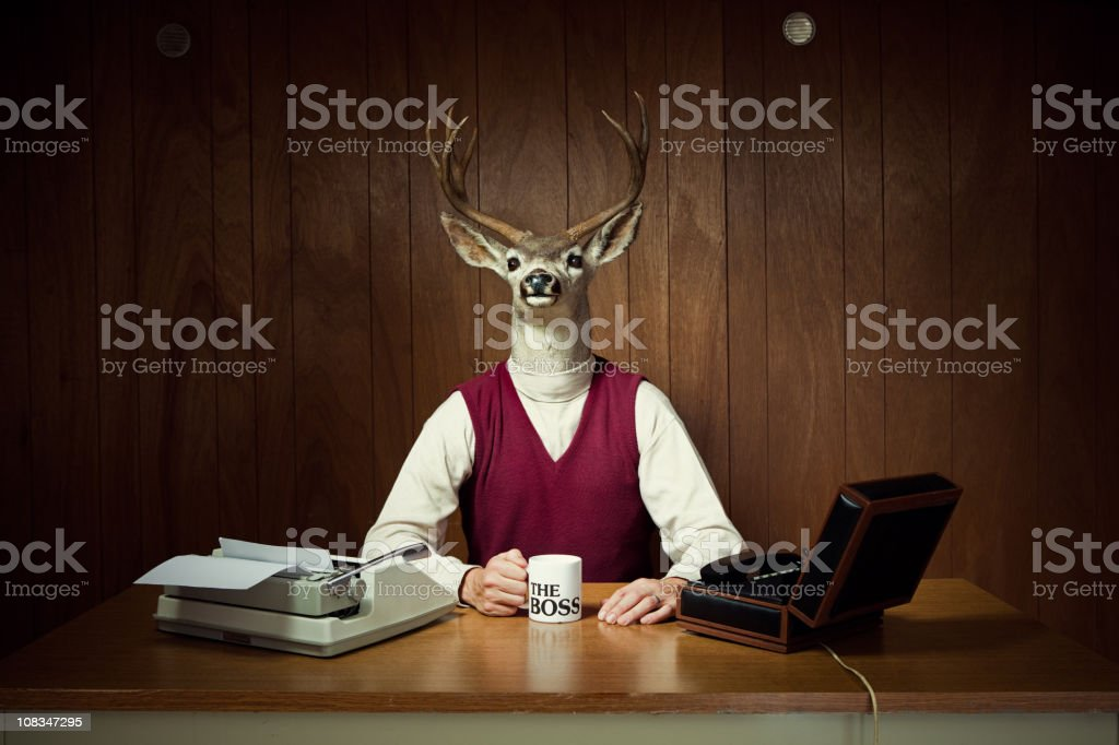 Deer CEO at His Desk stock photo