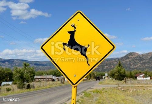 istock Deer crossing warning sign on road 504292379