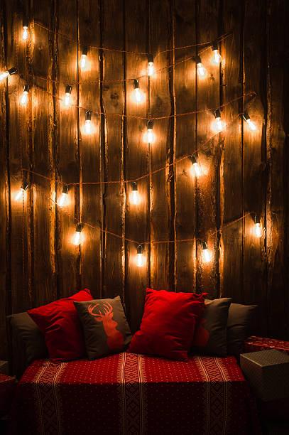 deer head on red hand made pillow wooden background in - weihnachten de stock-fotos und bilder