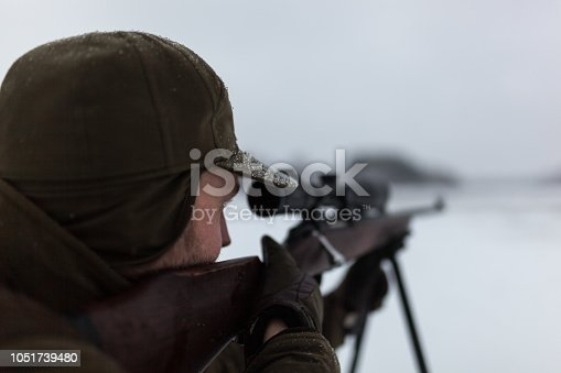 Deer hunting in the early morning during winter.