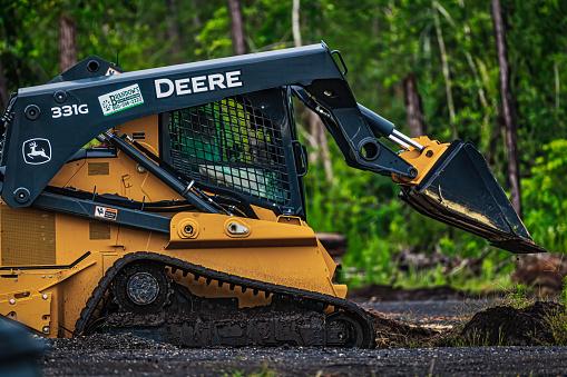 Panama City, Florida, USA. 06/08/2019.  John Deere 331G clearing and leveling land post hurricane michael