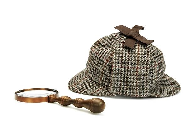 Deerstalker Cap And Vintage Magnifying Glass Iso Sherlock Holmes Deerstalker Cap And Vintage Magnifying Glass Isolated On White Background. Investigation Concept deerstalker hat stock pictures, royalty-free photos & images