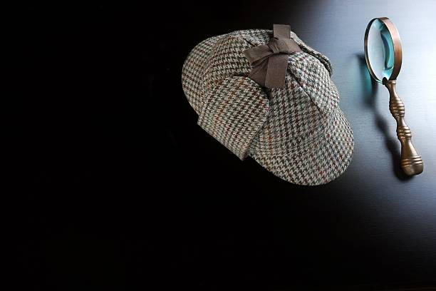 deerstalker hat,   and vintage  magnifying glass on black background - sherlock holmes stock photos and pictures
