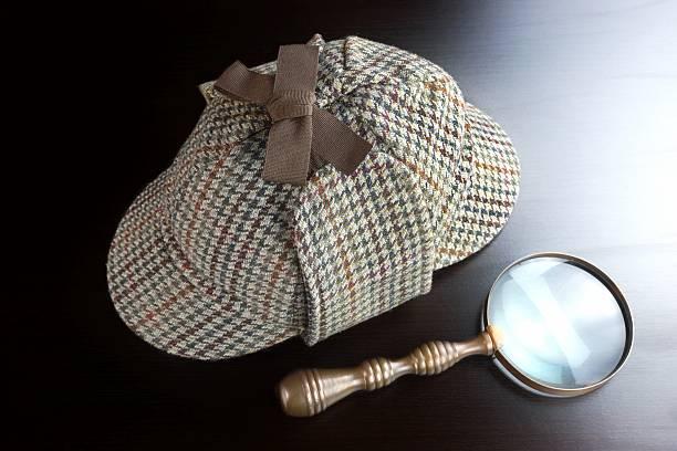 Deerstalker Hat,   And Vintage  Magnifying Glass On Black Background Sherlock Holmes Deerstalker Hat And Vintage  Magnifying Glass On The Black Wooden Table Background. Overhead View.  Investigation Concept. deerstalker hat stock pictures, royalty-free photos & images