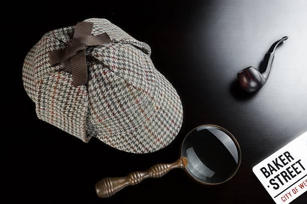 Deerstalker Hat,  Clock, Magnifier And Smoking Pipe On Table Sherlock Holmes Deerstalker Hat, Vintage Clock, Retro Magnifier And Smoking Pipe On The Black Table Background. Overhead View.  Investigation Concept. deerstalker hat stock pictures, royalty-free photos & images